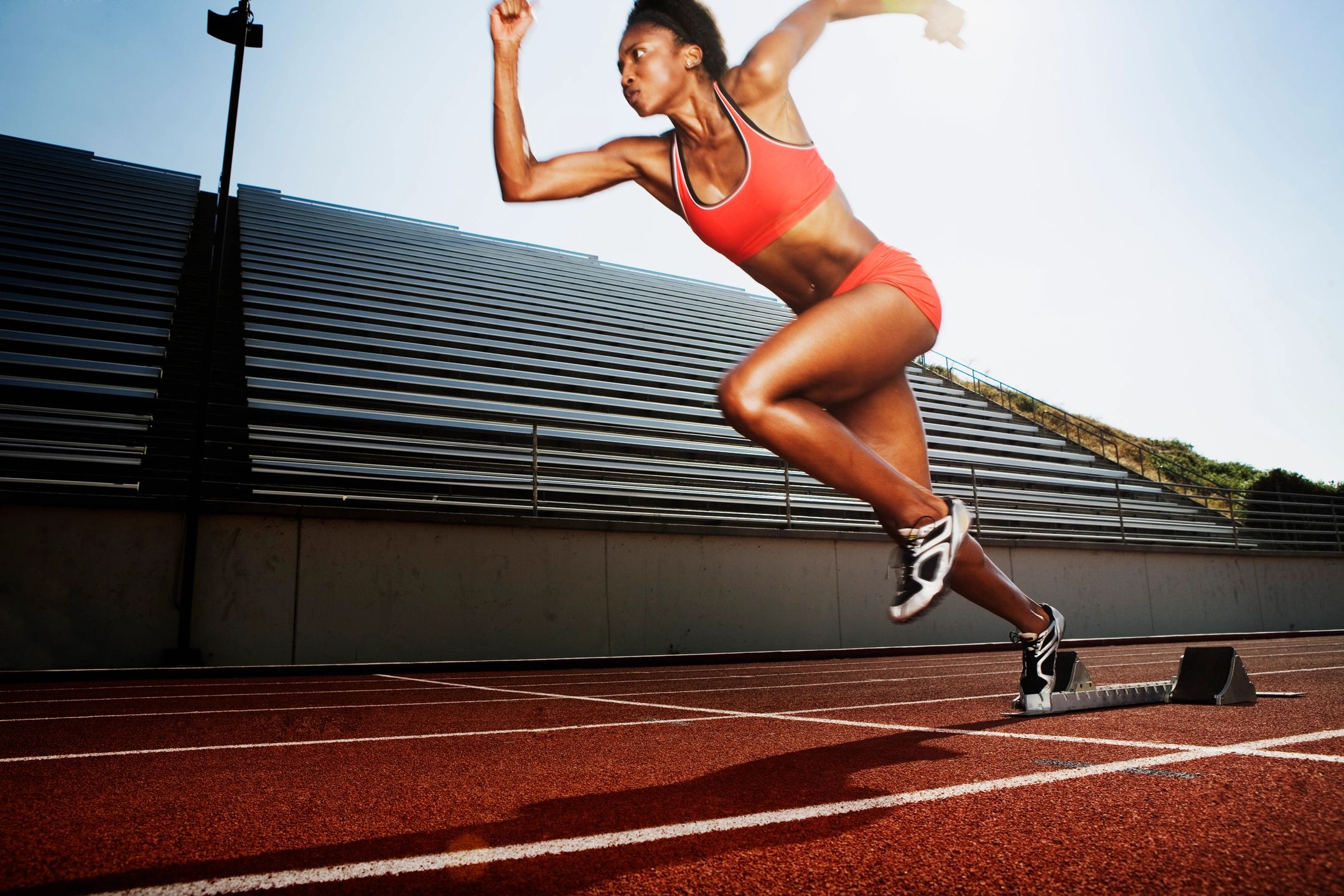 stock image of a professional athlete running on an olympic track
